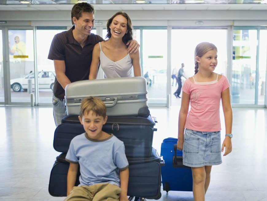 family-at-airport-with-luggage-1024x674